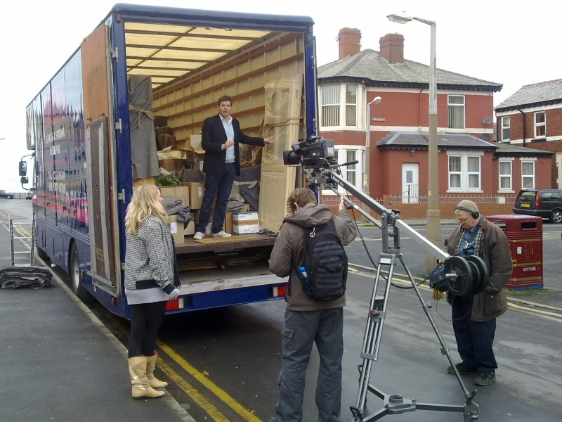 "Got an unusual job? Mark Duerden Smith in an Owens van filming the TV show ""Gutted"" in Blackpool."