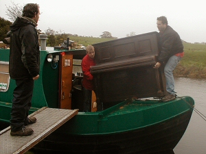 Photo - Moving an upright piano onto a canal barge at Salwick, near Preston on the Lancaster Canal. Everything is possible!!