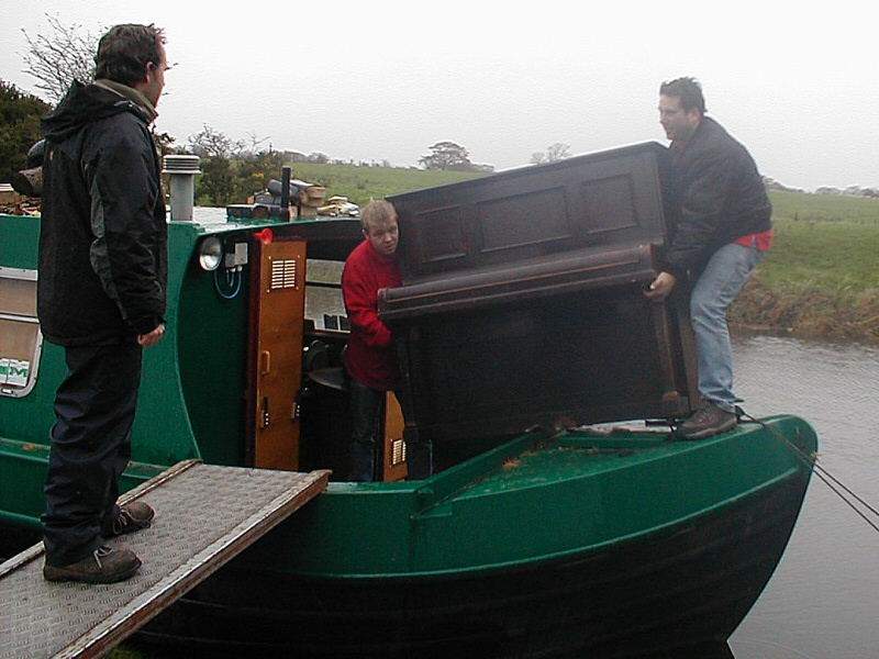 Think you have a challenging job? Moving an upright piano onto a canal barge on the Lancaster Canal.